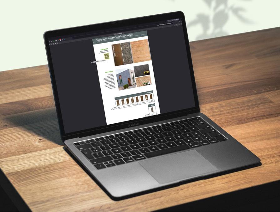 Der von OPUS Marketing designte Sichtschutzkatalog auf einem Notebook